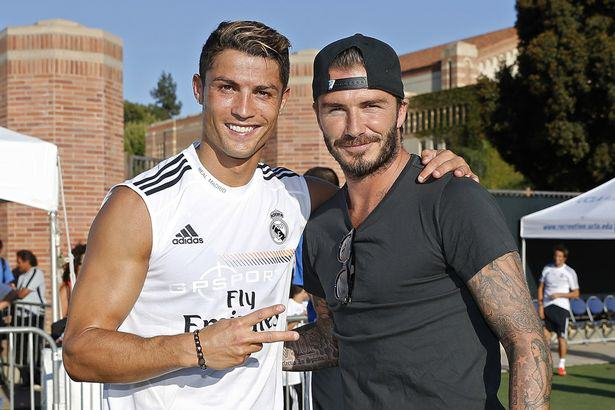 Cristiano Ronaldo of Real Madrid and former player David Beckham pose after a training session at UCLA Campus 2103871 David Beckham To Make Cristiano Ronaldo First Miami Super Signing?