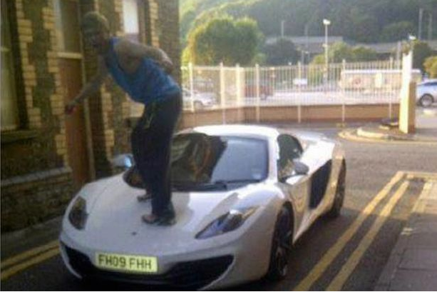car Idiot Jumps On £250K McClaren, Posts Photo, Gets Caught