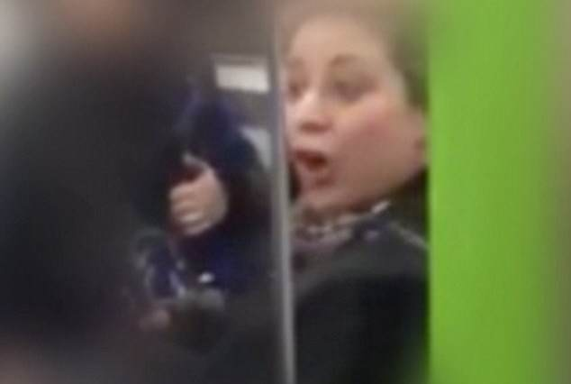 racist 634x426 Woman On Tube Caught On Camera Racially Abusing Two Men
