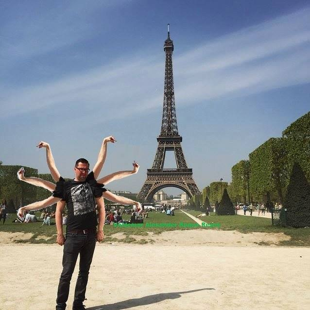 55 This Guy Posing Next To The Eiffel Tower Is The Latest Internet Craze