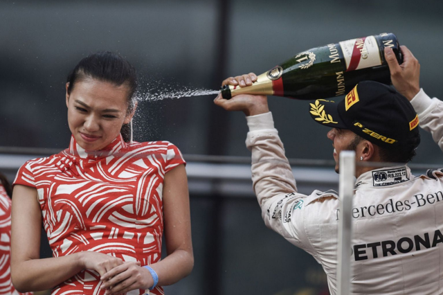 Screen Shot 2015 04 14 at 12.20.13 640x426 Lewis Hamilton Sprays Hostess In The Face After Winning Chinese Grand Prix