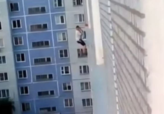 russian building web Man Tries To Impress Woman By Doing A Spiderman Down Her Building, Epically Fails