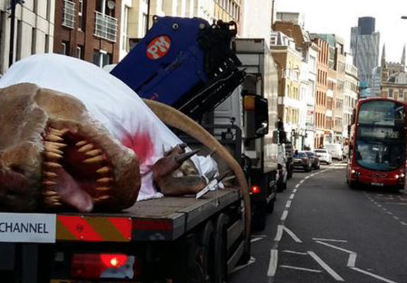 Dead T Rex Driven Through Streets Of London On Back Of Truck trex web