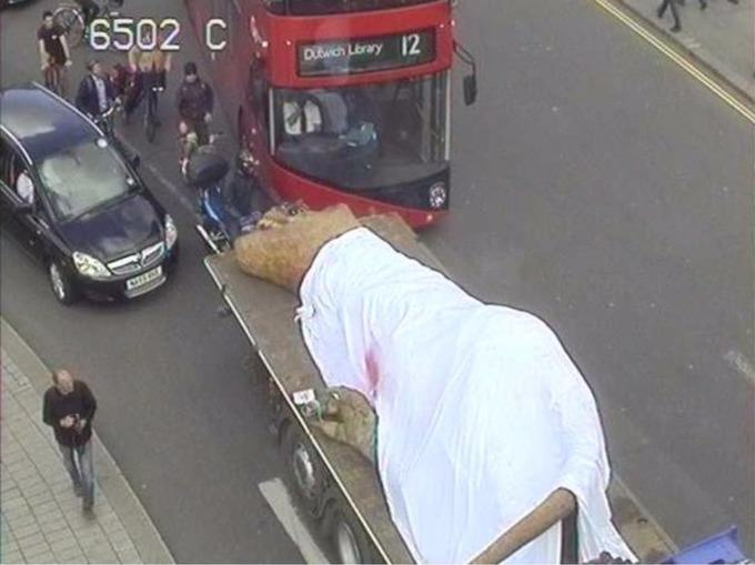 Dead T Rex Driven Through Streets Of London On Back Of Truck trex4