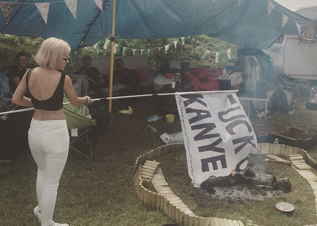 16 Lily Allen Took A Fuck Kanye Flag From A Reveller Then Burned It
