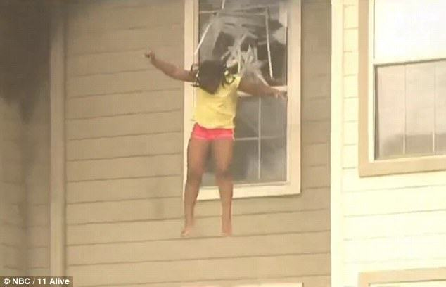 firewind Two Girls Caught On Camera Being Forced To Jump Through A Window To Escape House Fire