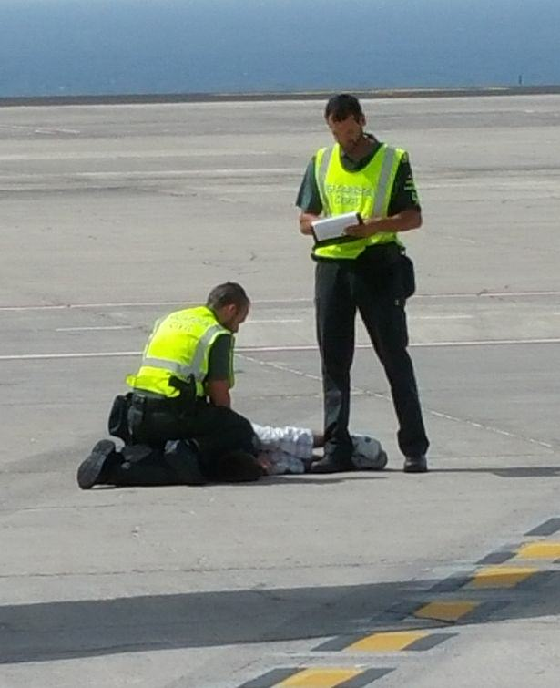 British Man Dragged Off Flight By Police For Causing Havoc runway1