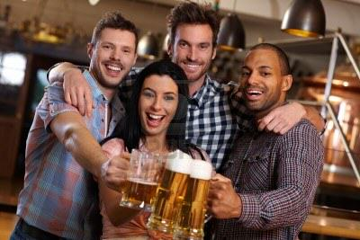 BREAKING NEWS: Drinking Water Does Nothing To Prevent A Hangover UNILAD 14821378 group of happy young friends drinking beer at pub laughing clinking glasses7