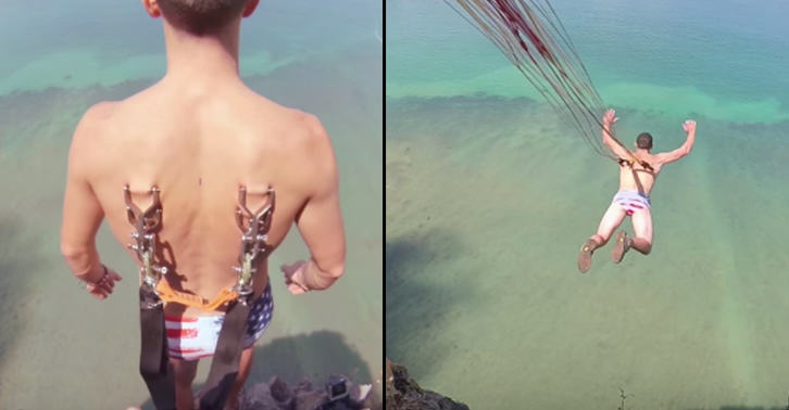 This Nutter Hooks Parachute Through His Skin Then Jumps Off A Cliff   Major NOPE! UPyBhmvdz
