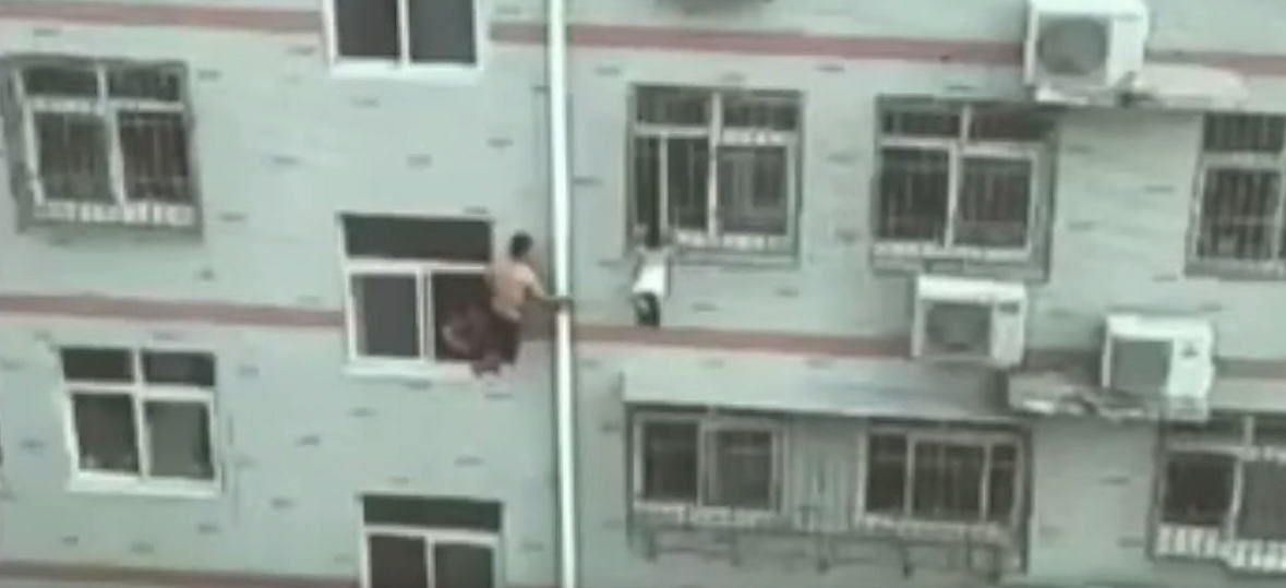 UNILAD Broom2 Man Saves Girl Hanging From Fourth Floor Windows Life With A Mop