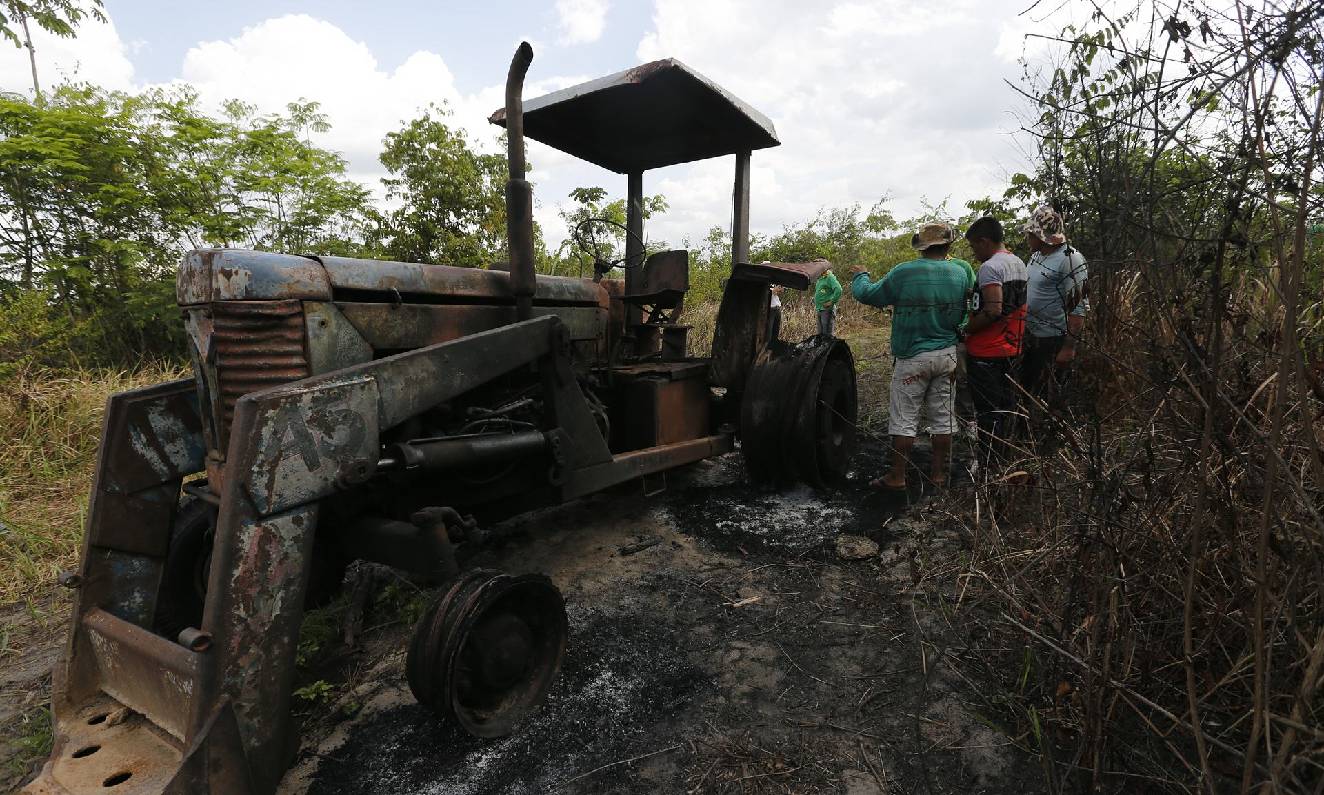 UNILAD Ka'apor Indians stand next to a logging tractor that they discovered and set on fire inside the indigenous territory one month before. Photograph Lunae ParrachoGreenpeace7 This Amazon Tribe Use Unusual Methods To Protect Their Land From Illegal Loggers