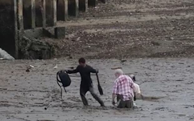 Fisherman Selflessly Lies Down In Mud To Rescue Stuck Tourists UNILAD fisherman270372