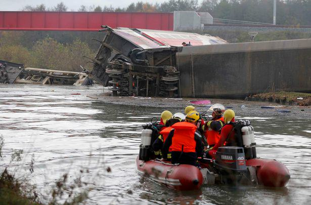 UNILAD Rescue workers search the wreckage of a test TGV train that derailed and crashed in a canal outside Eckwersheim near 181434 Five People Dead And Several Injured In French Train Crash Reports Say