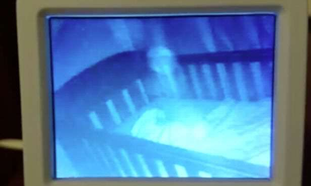 baby monitor Mum Films Ghost Baby In Cot With Sleeping Daughter