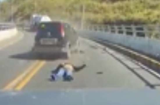 car crash 1 Video Shows Horrifying Moment Motorcyclist Is Taken Out In Head On Collision