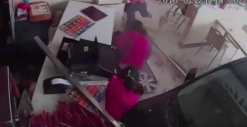 Screen Shot 2016 03 10 at 16.15.36 Shocking Moment Car Crashes Through Restaurant And Traps Young Girl
