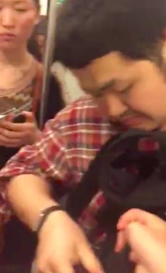 train3 Guy Caught With Upskirt Camera On Train Forced To Eat His SD Card