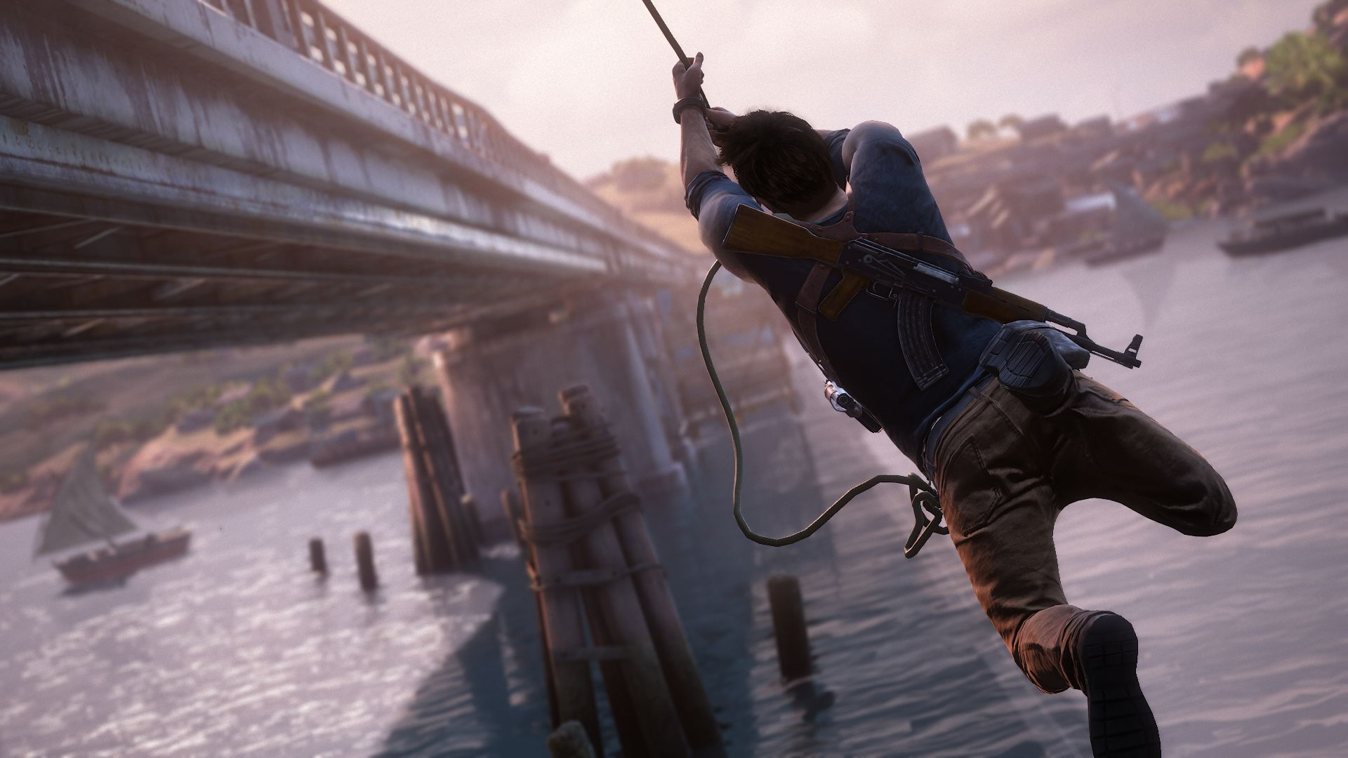 2759115 uncharted 4 drake rope bridge 1434429051 Uncharted 4s Nathan Drake Voice Actor On Role Of A Lifetime