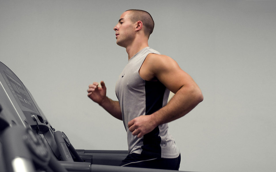 15397 a healthy young man running on a treadmill in a gym pv Heres Why Men Have Evolved To Value Looks Over Money
