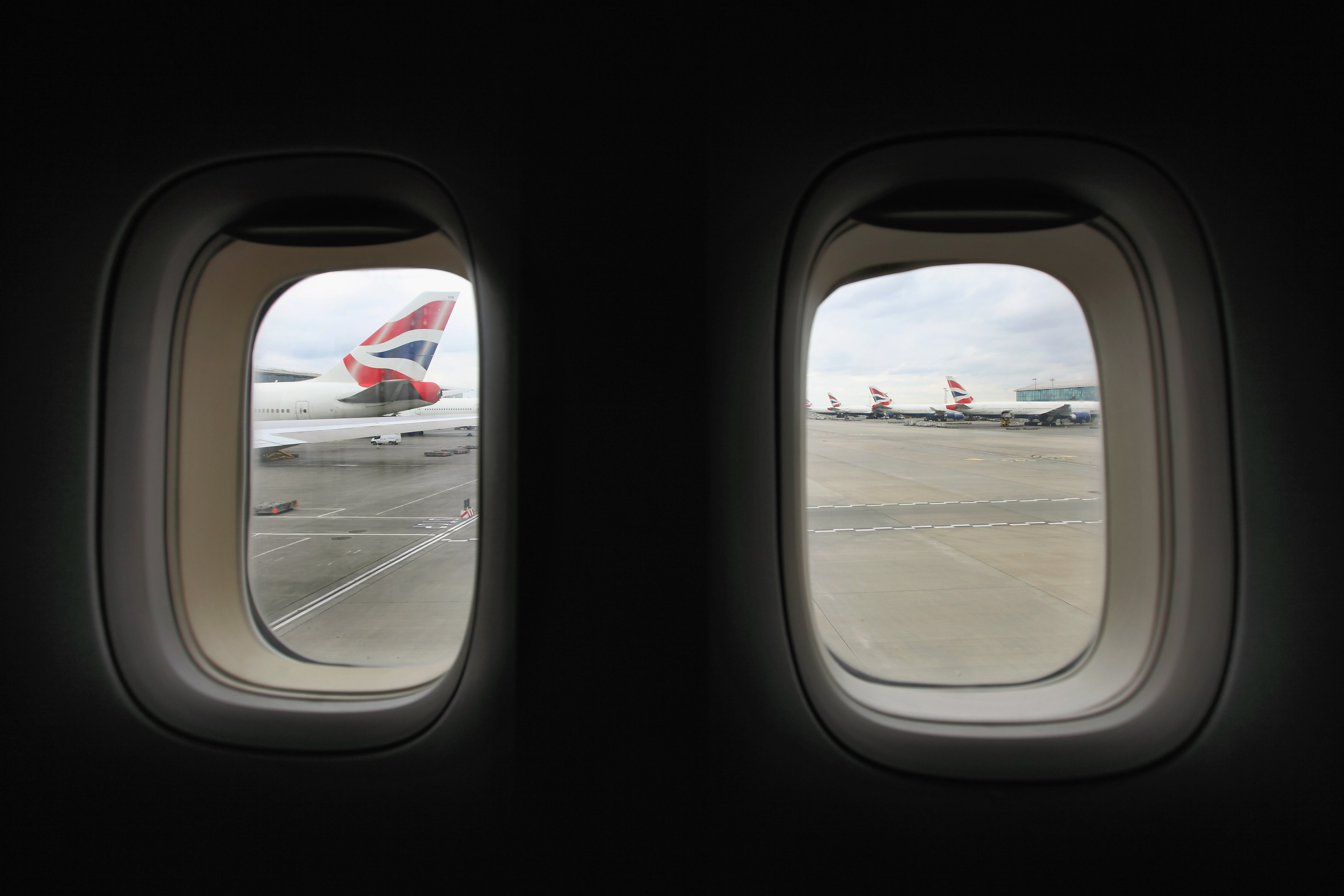 GettyImages 139504011 Heres What The Tiny Holes In Airplane Windows Are For