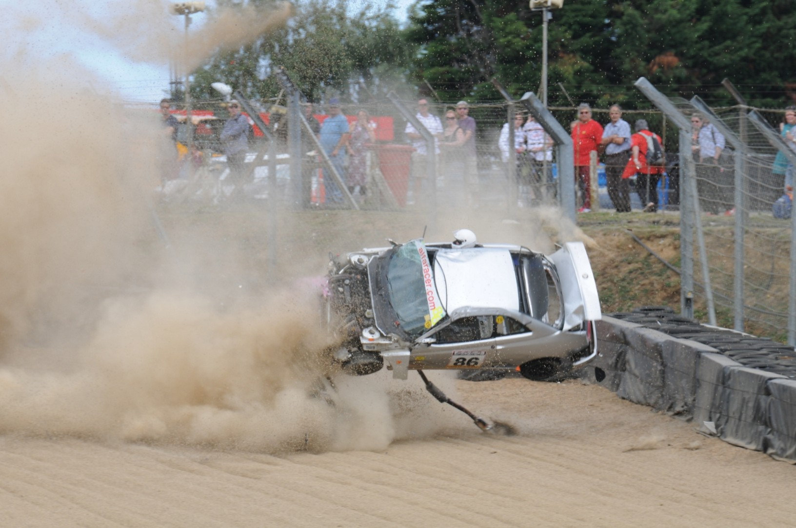 Incredible Moment Racing Driver Survives Crash With Head Out Of Window SWNS CRASH ROLL 12
