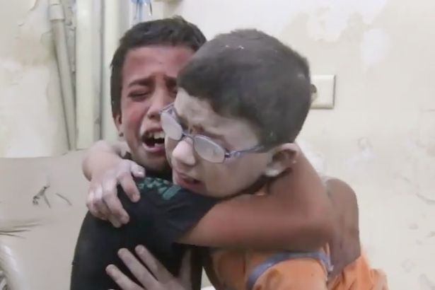 Screen Shot 2016 08 25 at 183501 Heartbreaking Video Shows Boys Grieving Brother Lost In Syria Airstrike