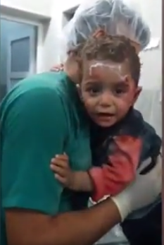 child1 Heartbreaking Video Of Syrian Boy Clinging On For Life After Airstrike Hits His House