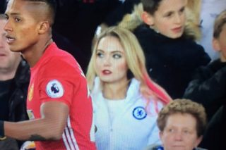 Fan Explains Why She Wore Chelsea Coat To Man Utd v Everton